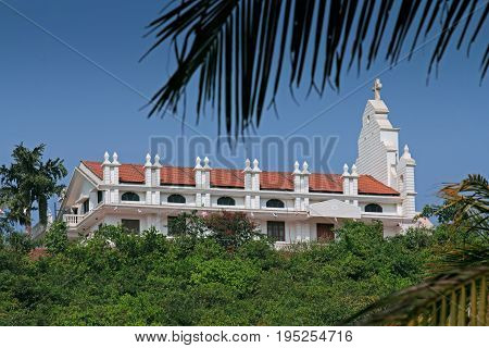 St. Roque Chapel BandoraPonda Goa India. This is newly constructed Chapel of catholic St. Roque in place of small Chapel of circa 1902. The chapel is on small hill surrounded by lush greenery
