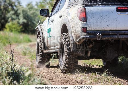 Off-road Racing Car Zipping Along A Country Road.