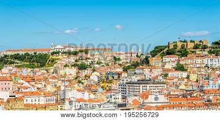 Panoramic view at the Alfama district with Sao Jorge catle from Santa Justa in Lisbon - Portugal