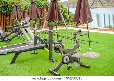 Gym on the terrace with an artificial turf by the sea in the open air Greece Crete