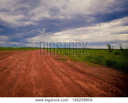 Dirt road in Prince Edward island leading to a windmill
