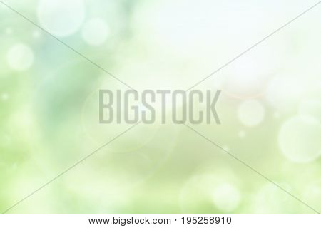 Bright abstract background of blurred circular green bokeh circles for summer backgrounds.