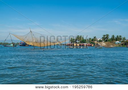 Vietnamese fishing boats on the Vin Cura Dai river, the mouth of the Thu Bon river near Hoi An in Vietnam.