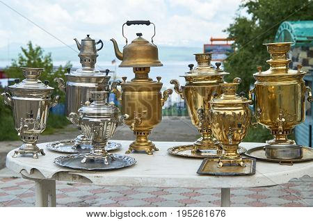 Vintage samovars and kettles on the market outdoors
