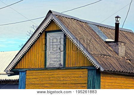 The roof and door of an old wooden barn