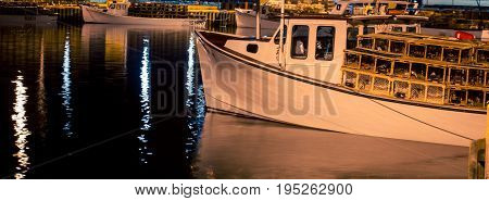 Lobster fishing boat at night in prince Edward island