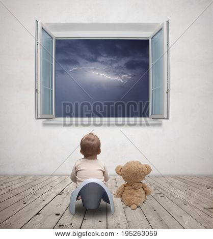 Little baby on the potty watching storm
