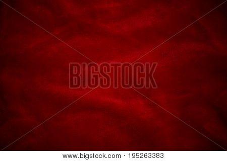 Red velvet silk background of a dark shade