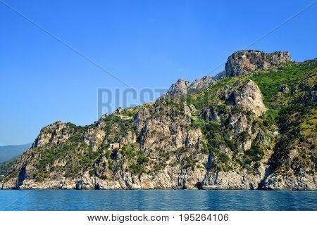 Rocky shores of the Mediterranean Sea between cities Salerno and Amalfi. Campania region,Italy.
