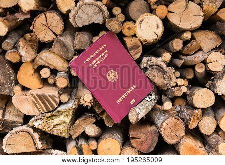 A German passport stuck between pieces of lumber