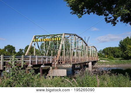 Steel Bridge Over River in Rural Setting