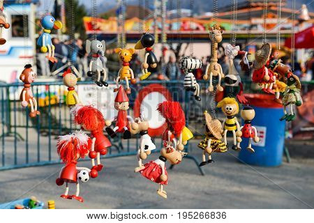 Agno Switzerland - 12 March 2016: puppets hanging at the market of a rural feast in Agno on Switzerland