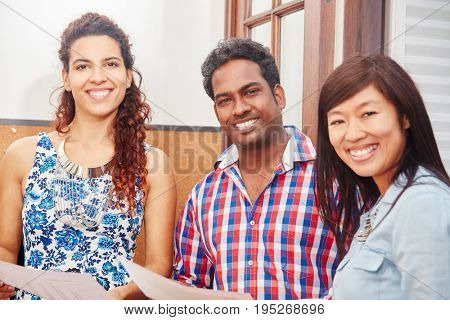 Interracial students as friends and colleagues in a happy team