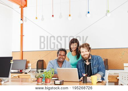 Startup business team working with laptop computer in cooperation