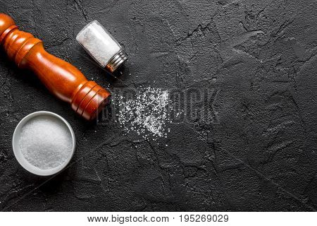 Cooking set with salt and saltcellar on kitchen dark table background top view mock up