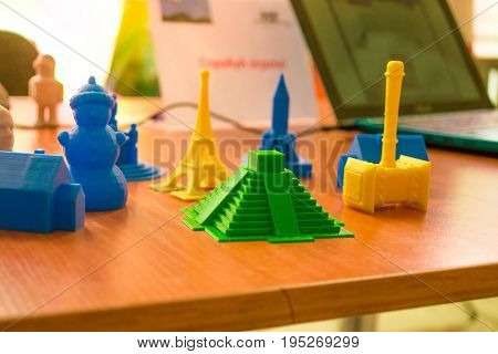 Small prototypes of different objects printed by a 3d printer close-up. Automatic three dimensional 3d printer performs plastic modeling in laboratory. Progressive modern additive technology