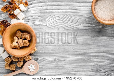 lumps and sanding sugar for cooking sweets on gray kitchen table background top view mock up