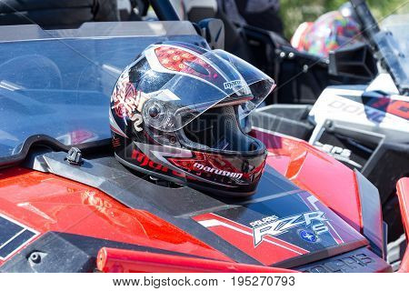 Samara Russia - May 13 2017: The motorcycle helmet rests on the quad bike