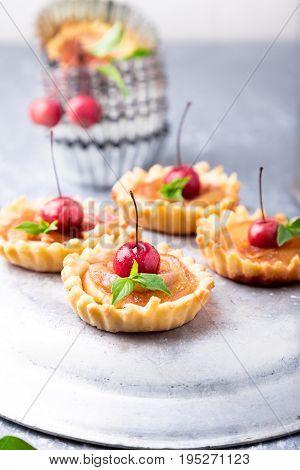 Apple Caramel Little Tarts On Grey Background. French Tatin With Paradise Apple.