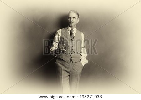 Antique Plate Photo Of 1920S Businessman With Glass Of Whiskey Leaning Against Wall.