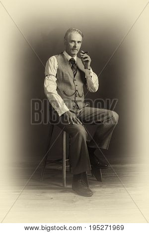 Antique Plate Photo Of Middle Aged Vintage 1920S Man Wearing Suit With Cigar Sitting On Wooden Stool