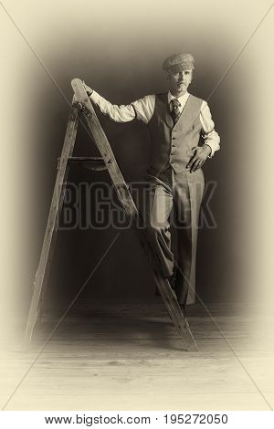 Antique Plate Photo Of Vintage 1920S Man In Suit Standing On Old Wooden Ladder.