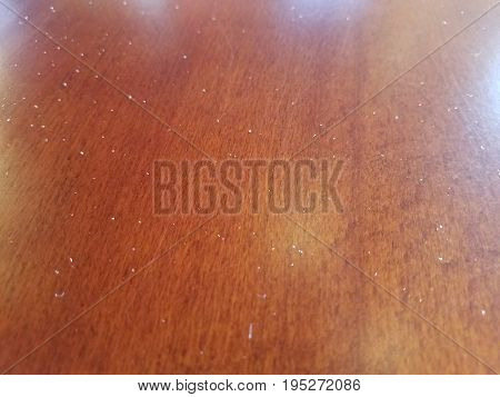 top of a brown table with several grains of salt