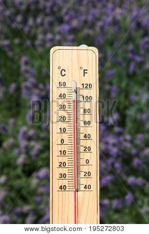 Thermometer on the summer heat with hot temperature