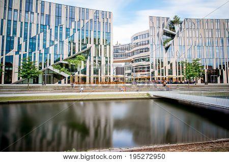 DUSSELDORF, GERMANY - July 04, 2017: Modern office building on the Jan Wellem square near the Hofgarten in Dusseldorf. Long exposure image technic