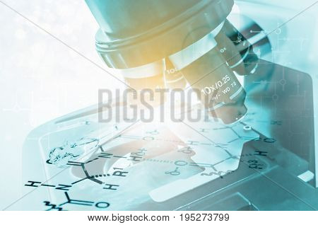 Laboratory Microscope. Scientific and healthcare research background Double exposure laboratory glass Pipette on Chemical formula paper with light tone select focus