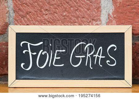 Foie gras on a blackboard in France