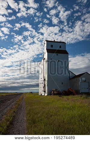 White Wooden Grain Elevator Under Gorgeous Blue Sky