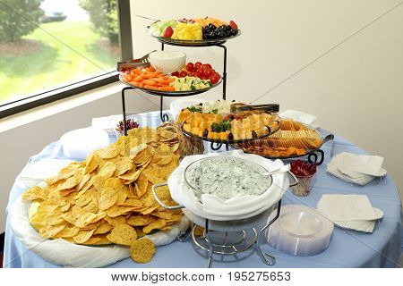 Pre Party Appetizer Spread Hors D'oeuvres with Cheese Plate, Vegetable Plate, Fruit Dish, Salad, Cracker Plate, Dip, And Chips