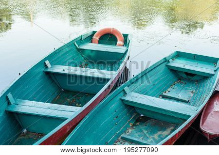 Old Boat With Oar Near River Or Beautiful Lake. Calm Sunset On The Nature. Fishing Boat