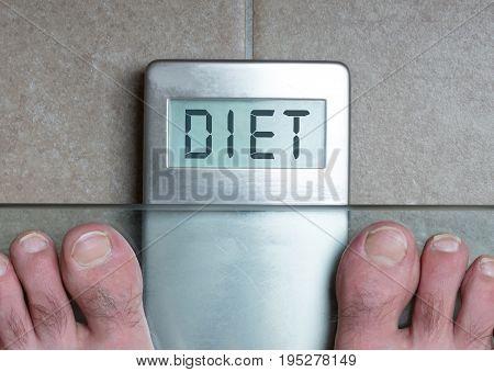Man's Feet On Weight Scale - Diet