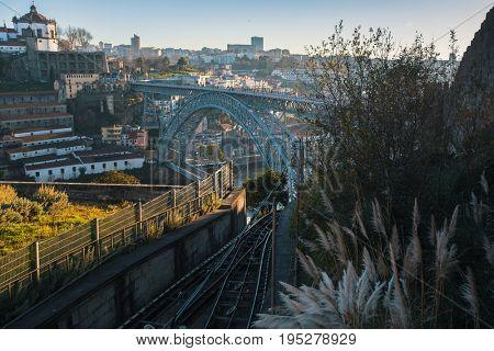 View of Douro river and Dom Luis I bridge, Porto, Portugal.