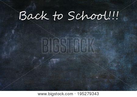 Dusty blank school chalkboard or blackboard with room for copy space.