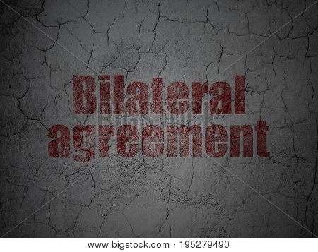 Insurance concept: Red Bilateral Agreement on grunge textured concrete wall background