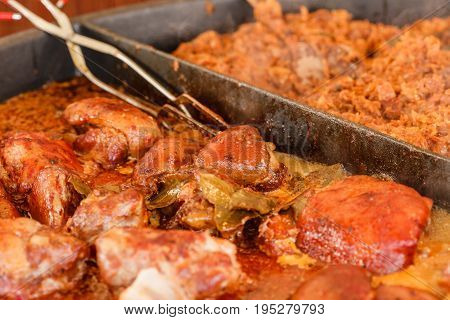 Fat christmas food concept. Traditional polish dishes sauerkraut and chicken meat closeup