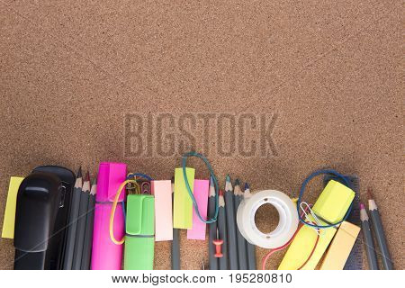 Background image of a variety of stationary on a wooden background