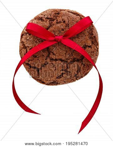 Chocolate cookie with red bow isolated on white background