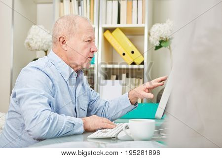 Business senior citizen working with computer on a research