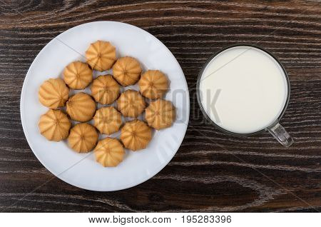 Shortbread In White Plate And Cup Of Milk On Table