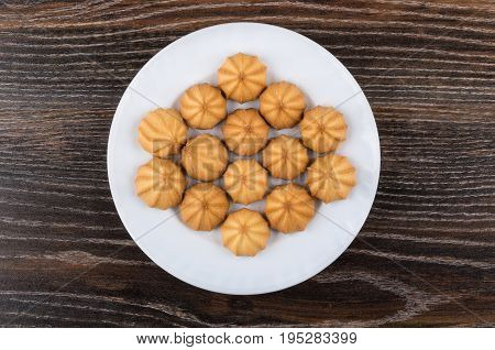 Shortbread In White Plate On Dark Wooden Table