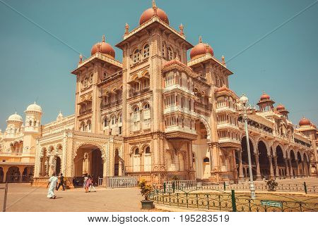 MYSORE, INDIA - FEB 17, 2017: Palace of Mysore built for royal family in 1912 and some tourists on February 17, 2017. With population 900000 Mysore is the cultural capital of Karnataka