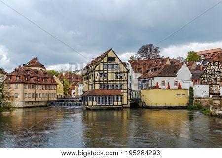 Embankment dam on Regnitz river in Bamberg city center Germany