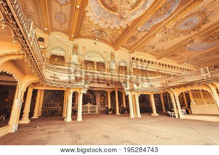 MYSORE, INDIA - FEB 17, 2017: Ceiling with art inside the Audience Hall of the royal Palace of Mysore built in 1912 on February 17, 2017. With population 900000 Mysore is the cultural capital of Karnataka