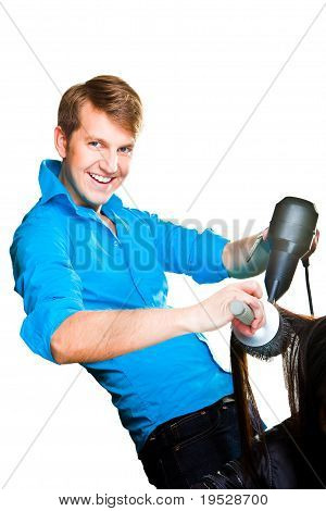 hairdresser man with hair dryer on isolated white
