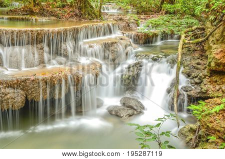 Huay mae kamin waterfall in Kanchanaburi Thailand in Abstract background