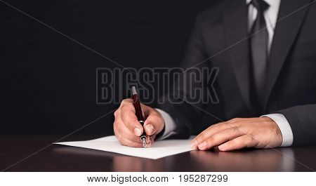 Businessman Writing A Legal Document In His Office